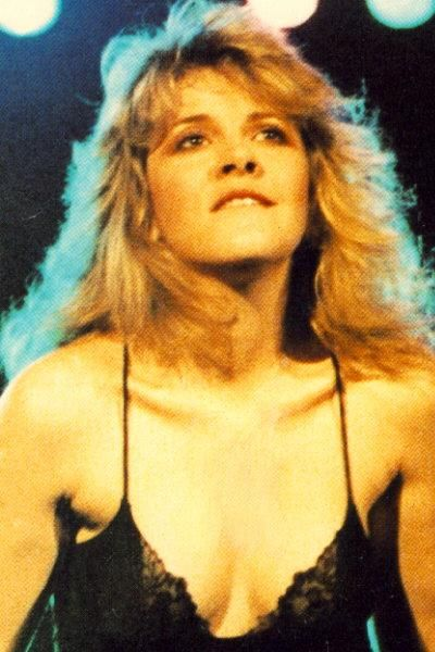 So funny.. for many many years.. this was a big habit of Stevie's biting her lip.  She also had Breast implants (as you can clearly see here) but they started to leak so she got them removed.