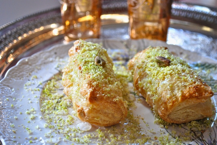 Middle Eastern Dessert Borekas.  Made with sweet semolina and orange blossom syrup.  A must try recipe: Semolina Boreka, Sweet Semolina, Middle Eastern, Orange Blossoms, Blossoms Scented, Blossoms Syrup, Desserts Fillings, Puff Pastries, Vegans Desserts