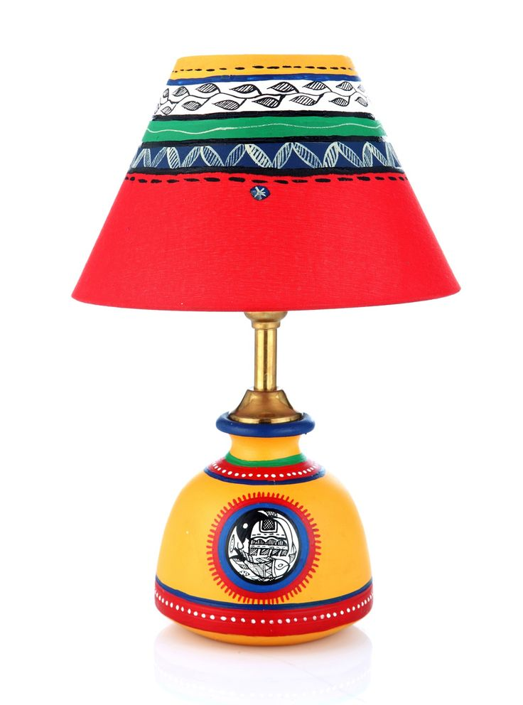 This unique terracotta matki lamp has been hand painted in Yellow to pep up your mood. The shade has also been designed in red for color coordination with the earthen lamp. Try it : this lamp will usher in enthusiasm into your daily life.