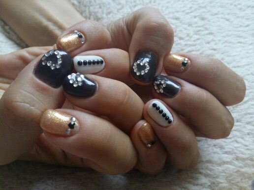 Simple black, white and gold with lots of rhinestones.