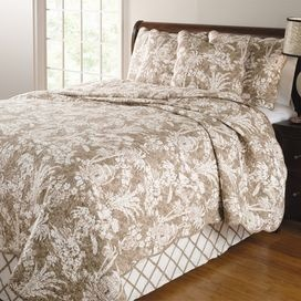 Taupe bedding set with a tropical floral motif.Product: Full/Queen quilt, 2 standard shams and 1 bedskirt Construction Material: Cotton and linen face with cotton fillColor: Taupe and ivory  Features:  Print with gazebos, palm trees and covered wooden bridges  Tailored bedskirt has a 15 drop Oversized for better mattress coverage      Dimensions: Standard Sham: 20 x 26 eachFull/Queen Quilt: 90 x 90 Note:  Standard shams do not include inserts Cleaning and Care: Machine washable