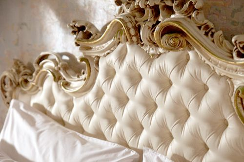Ornate white and gold tufted headboard