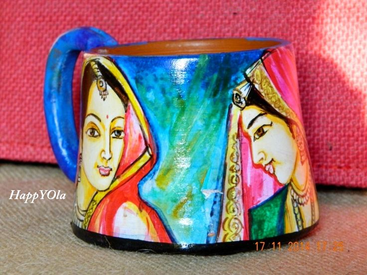 Hand painted terracotta mugs depicting beautiful traditional Indian women. These hand painted mugs are exquisite form of art work.