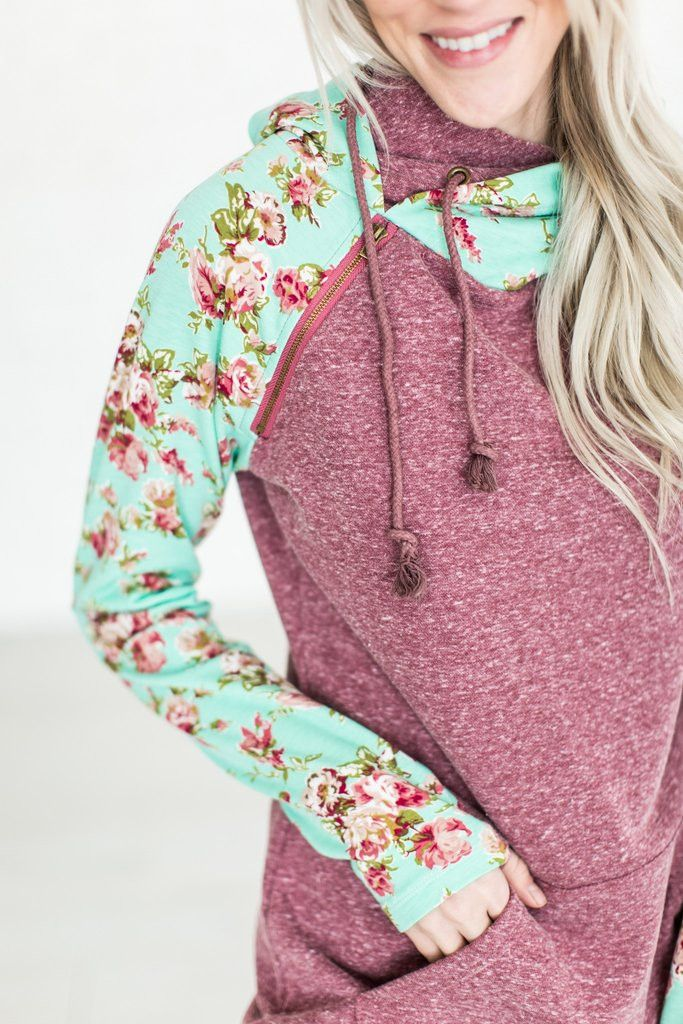 Look cute and casual at the same time with this double hoodie! Features a fun zipper detail and floral print accents. Also has front pockets and thumb holes to make it even more cozy!