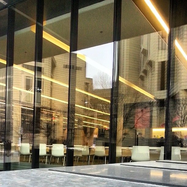 Robarts library reflected in the windows of the new Rotman building on the University of Toronto campus.
