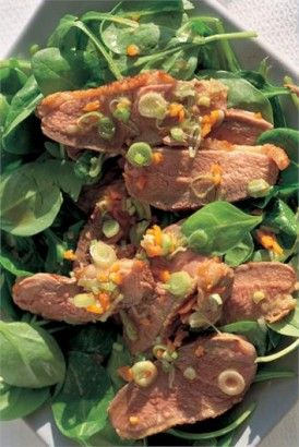 GINGERY HOT DUCK SALAD: This recipe is a slight reworking of a Cambodian beef salad I often make; here the lime juice in the steeping mixture (which turns into the dressing) is supplemented with orange juice (Asian evocations of duck a l'orange and all that), but in season, around January, use instead of this combination the fragrantly acerbic juice of one Seville orange.