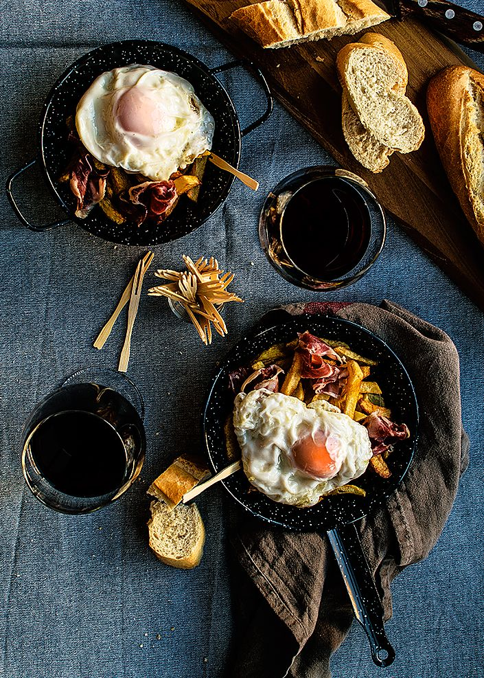 Fried eggs with cured ham or huevos estrellados con jamón is a complete dish or tapa make with fried potatoes, fried eggs and cured ham.
