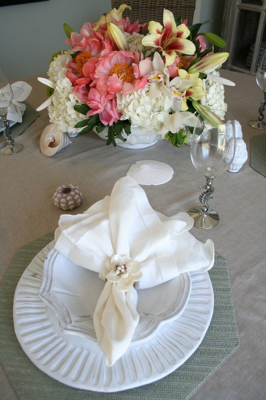 Seashell accents are so pretty on this dining room table