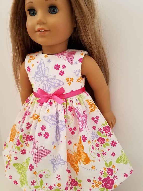 This is a fun little dress made just for 18 inch dolls. It features bright, big colorful butterflies with a pink satin ribbon around the waist. Its easy to slip on and off with velcro closure in the back. Made To Order ! Made to fit 18 inch dolls such as American Girl, Our Generation,
