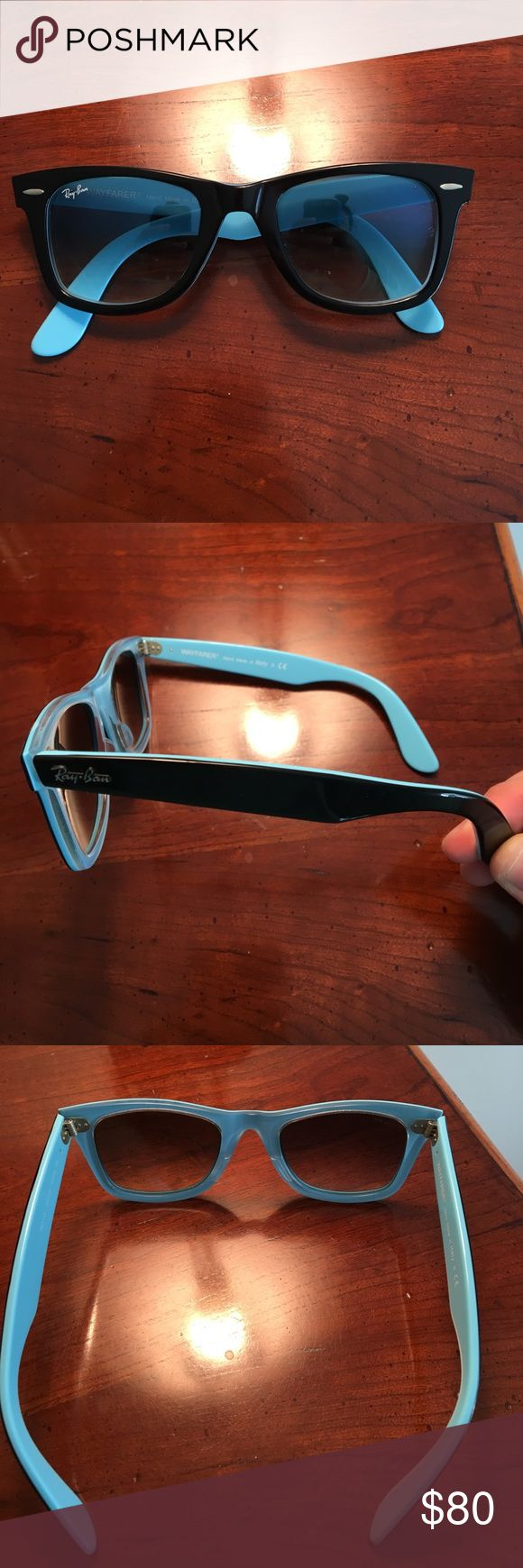 ray ban sunglasses wayfarer The original black Ray Ban Wayfarer with light blue on the inside I only wrote them a few times no scratches essentially brand new comes with the case and the eyeglass cleaner Ray-Ban Accessories Glasses