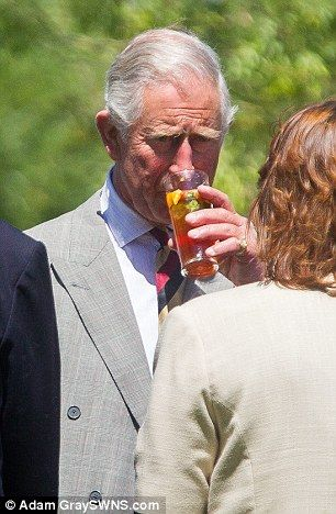 It's Pimms o'clock! Prince Charles enjoys a Pimms as he chats to a local villager 8 July 2014