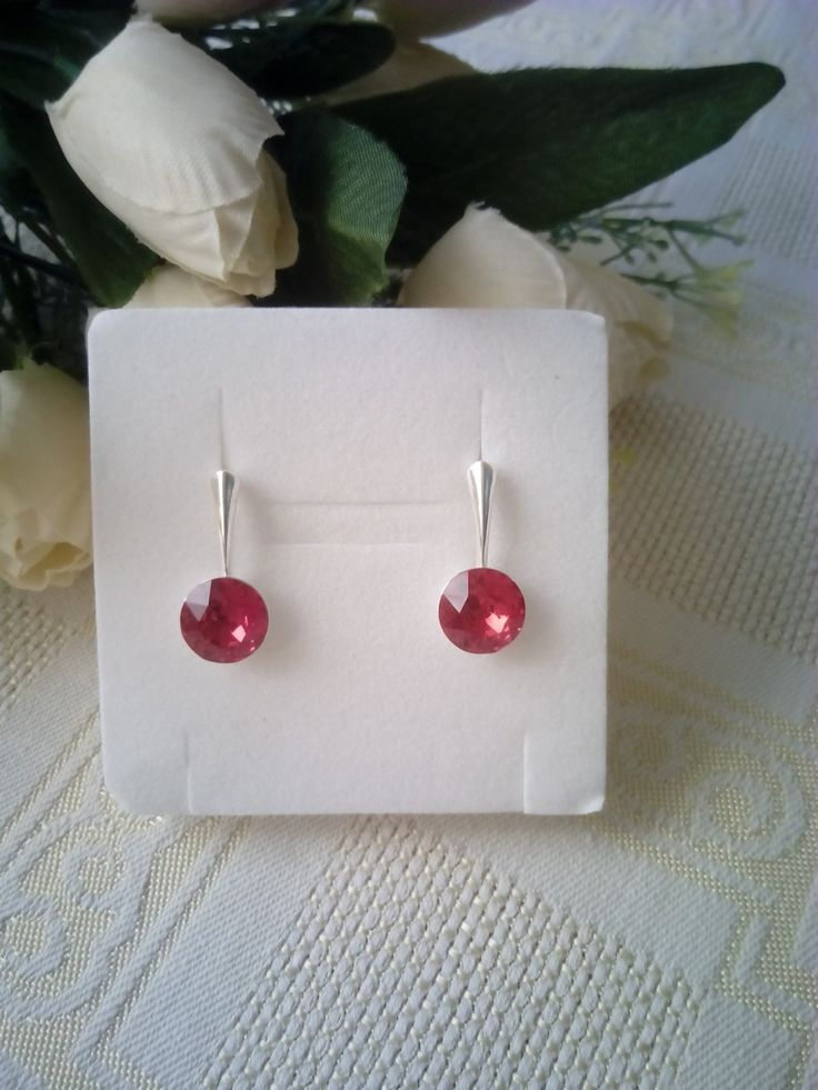 Light siam Swarovski crystal earrings.