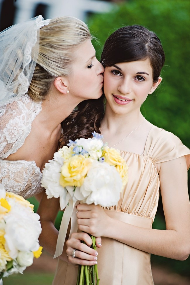 I will definitely want to take a picture like this with my maid of honor (my little sister).