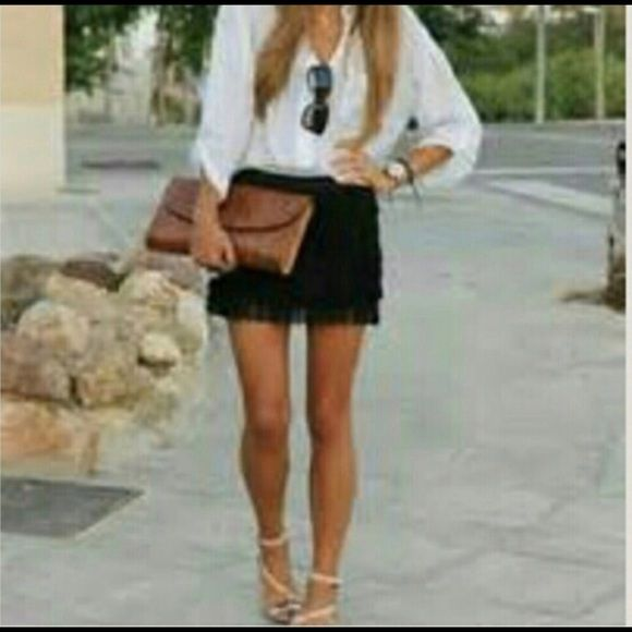 🔥Chloe Classy Detailed Fringe Black Mini Skirt 🔥 Gorgeous is only word I have for this sexy Chloe black detailed fringe mini skirt. Its sexy & classy & very high quality . Unfortanatly my sister does not fit in it anymore after a twin childbirth but I'm sure another young lady can make great use of it. It was worn one time so basically brand new. 50% Viscose & 50% cotton. Zips up the back .Very sexy & you can dress it up or down. Any Q's just tag me. Thank you for peeking 😉 Chloe Skirts…