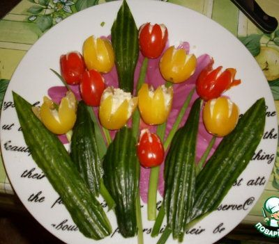 Variant of Tulips edible arrangement stuffed red & yellow cherry tomatoes with cream cheese & pesto for flower heads with green onion stems. Decorate with cucumber leaves.