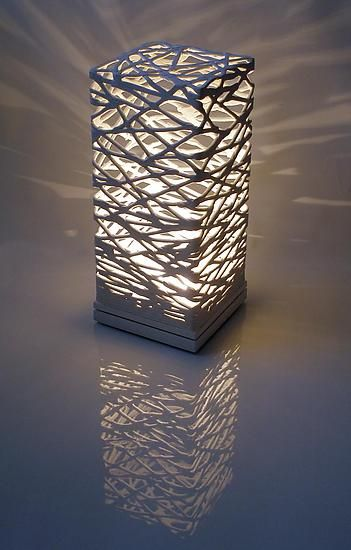 "Muhammad Moussa - ""Table Luminaire"". Ceramic Table Lamp. Low fire white clay shade and a solid hard wood base (maple or similar)."