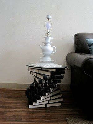End Table ~ base is made from stacked old encyclopedias and the topped with a piece of glass.