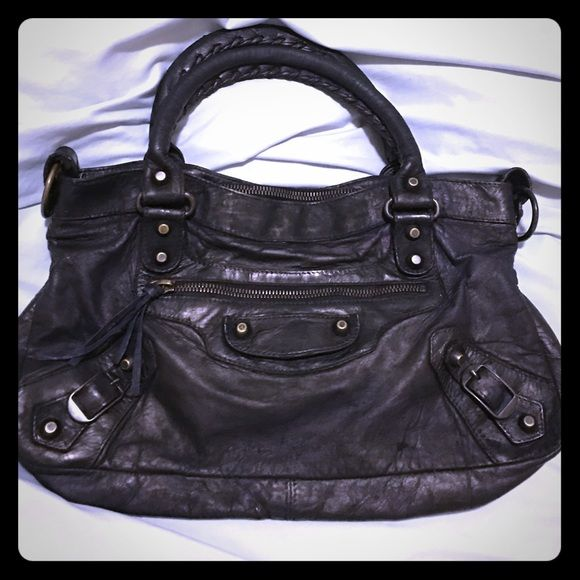 Authentic Balenciaga First bag Selling this beautiful Balenciaga First bag. Brass hardware. This bag has been redyed to black. Bought it for 1250. Metal tag shows original color. Open for reasonable offers. Slightly cheaper via V1nted Balenciaga Bags Shoulder Bags