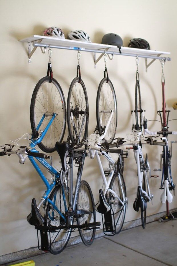 'Good Ideas for You' shows us how to make this DIY bike rack from a shelf, a pole, and some straps and hooks. Read down to the bottom of the page to find the link for the full tutorial.