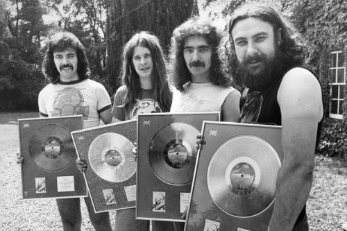 Black Sabbath posing with the silver discs they received for their record Technical Ecstasy, 1977.