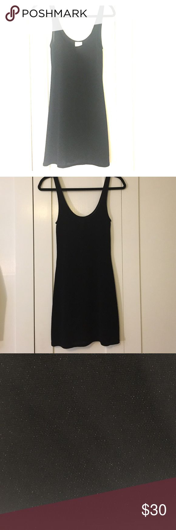 Free People black mini dress Form fitting nylon/metallic mini dress. Slip underneath recommended. Every woman should have at least one little black dress in their arsenal! Free People Dresses Mini