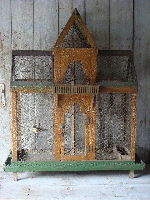 antique birdcage   I LOVE it!  Looks home made!