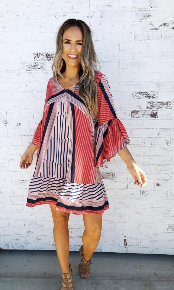 5928e6541cd Spring fashion. Spring style. Summer dress. Bold prints. Fun patterns. Bump  friendly. Bell sleeves. V-neckline. Fun and flirty.