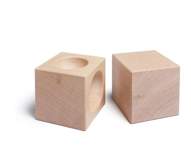 Two solid hardwood cubes, ergonomically designed to smash together to form the perfect nutcracker.    Made in Germany of waxed beech, this unique piece has three different sized hollows to suit your nut of choice.