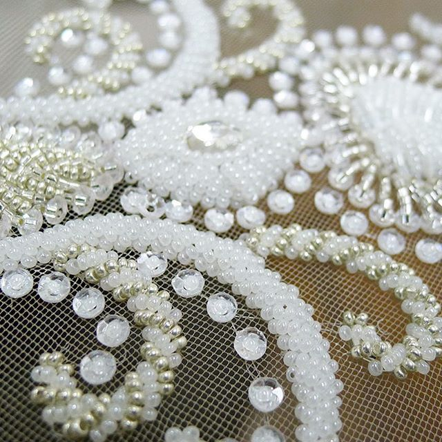 Wedding dress bead embroidery on netting.