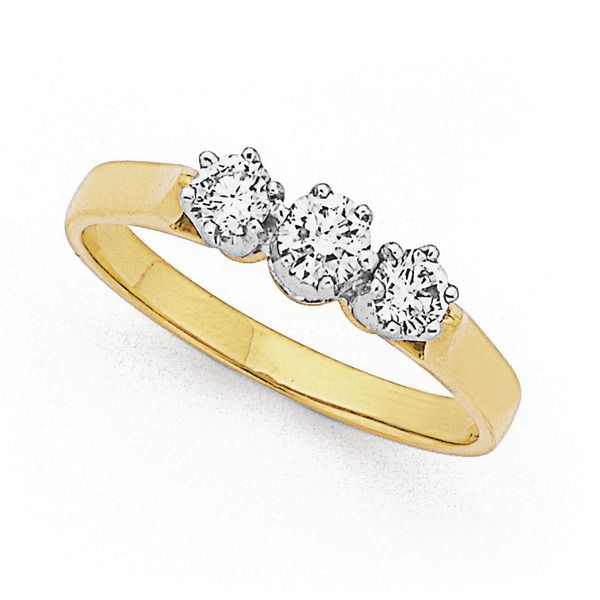 This is a classic three stone 18ct, Diamond Ring with a Total Diamond Weight of .50ct