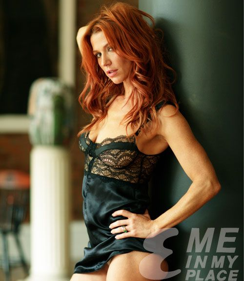 Poppy Montgomery shot by MeInMyPlace for Esquire Magazine. A redhead in a black neglige...that works for me...