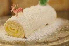 De kerststronk, gebaseerd op de traditionele rolcake, met mangocompote, slagroom en witte chocolade.