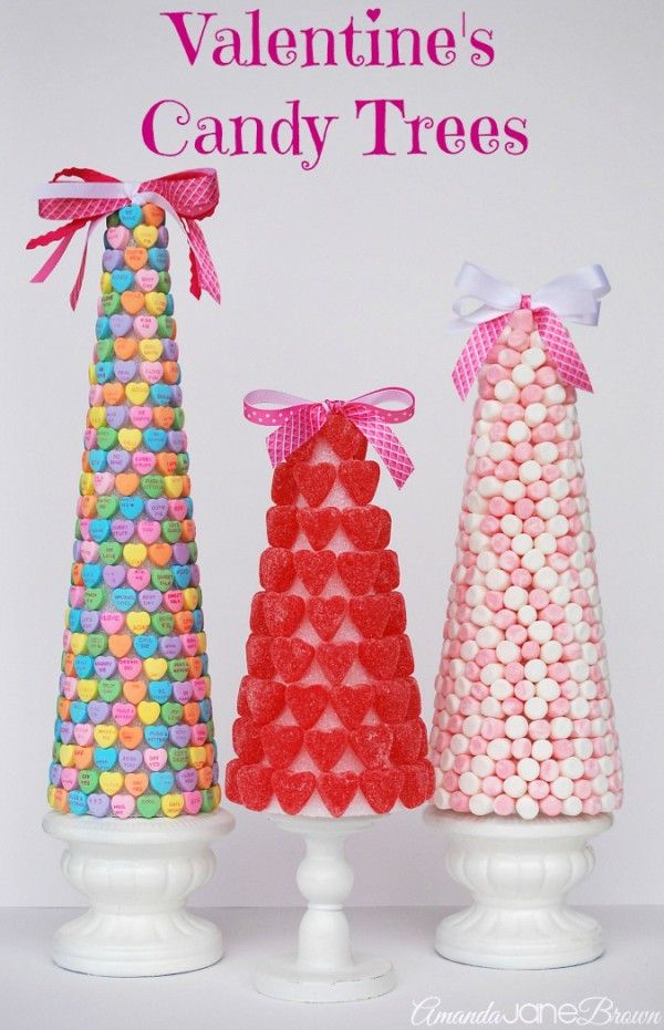Valentine'sCandyTrees - Styrofoam cones found at Dollar Tree, Hobby Lobby or Michaels, candy hearts, gummy hearts, etc., glue, glue gun, ribbon and pedestal