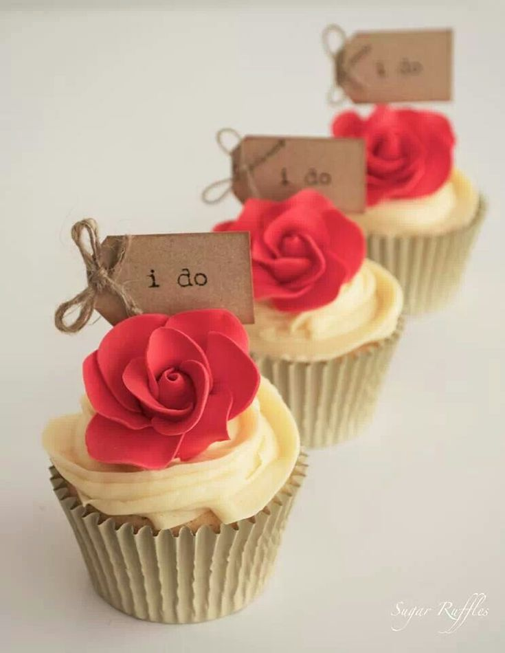 Wedding cupcakes, but with white icing and caramel colored flowers. Maybe an edible pearl or two