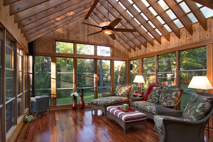 Polycarbonate roof panels flood the sunroom with filtered natural light [From: Quigley Architects / Saari & Forrai Photography]