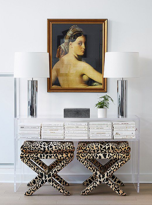 David tucked leopard-print stools beneath an acrylic console. He added the vintage lamps to play off the chrome pieces in other parts of the room.
