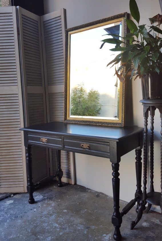 Elegant hall table painted in black chalk paint and sealed with clear wax