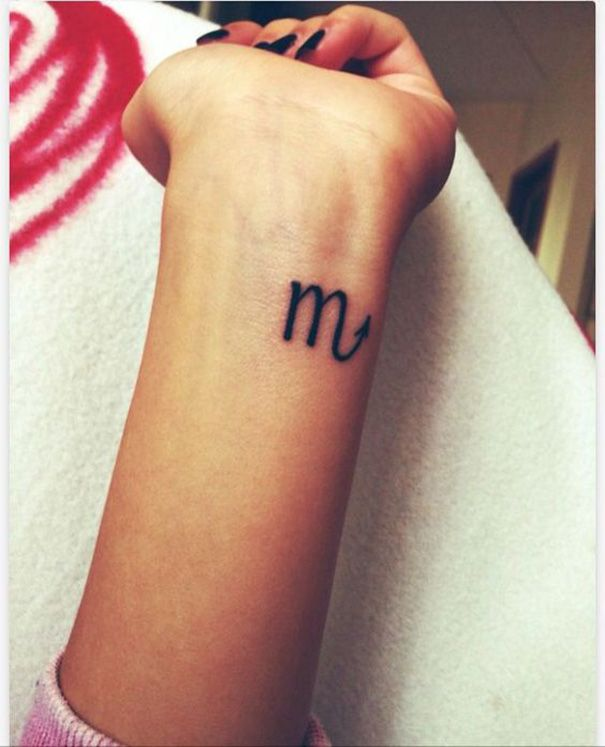 scorpio zodiac tattoo on wrist