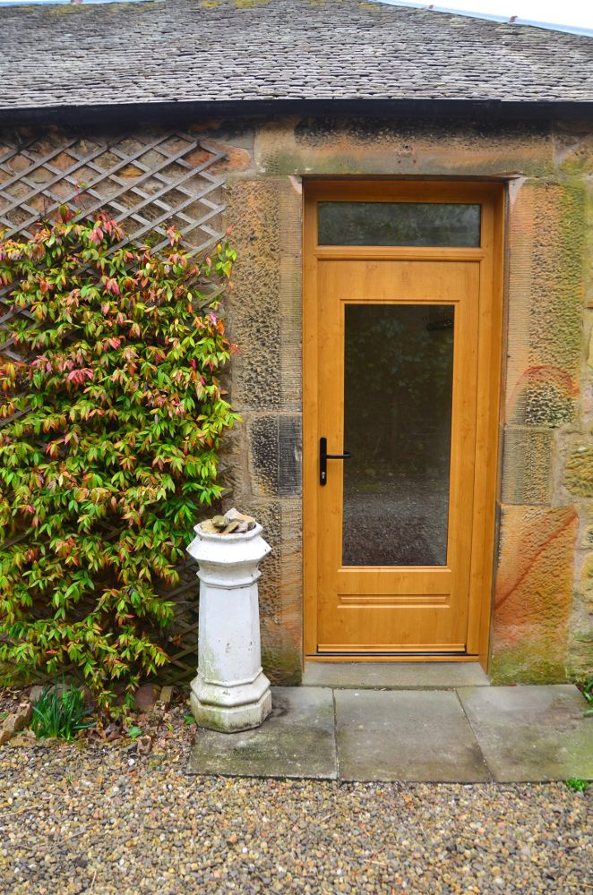 We absolutely love this Rockdoor and we think it looks fantastic on the property. They colours and style work together perfectly. A Light Oak Classic with clear glass and fan light. #Rockdoor #Homedecor