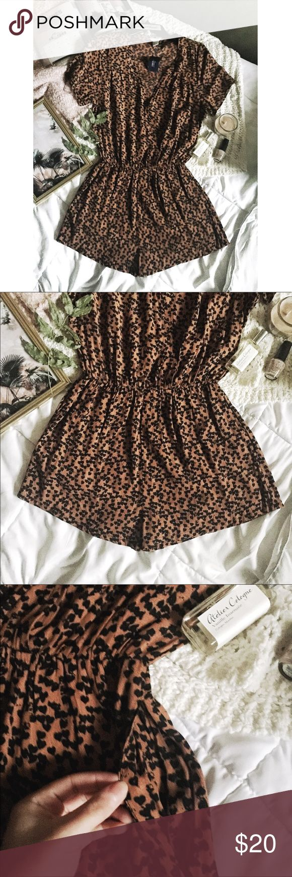 """F21•Brown/Black Heart Shaped Leopard Print Romper Forever 21 Brown/Black Heart Shaped Leopard Print Romper/Jumpsuit/Playsuit  Condition: New With Tags--no flaws or damages  Size Small Color is a beautiful brown/dark orange color with black """"heart shaped"""" patter--however from far alway, it has leopard look ✨ Features: Pockets Faux wrap front (with snap button)  Vneck  Short sleeve  Elastic waist  Made of 100% viscose  Approximate measurements: Length: 31""""  Bust: 18"""" Armpit to armpit  Shorts…"""