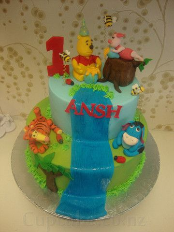 Winnie the Pooh and his friends 1st birthday cake