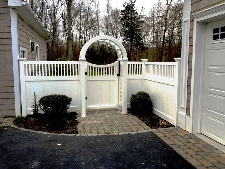 Vinyl Privacy Fencing with an Arbor and Walk Gate                                                                                                                                                      More