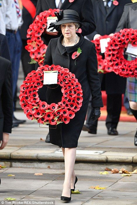 Britain honours its war dead with silent tribute on Remembrance Sunday