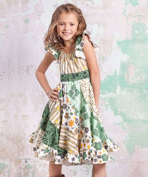 With a darling mix of prints and ruffle trim, this dress is ready for a walk on the smile side. A fabulously flared skirt and soft cotton keep cuties comfy with delightful ease.
