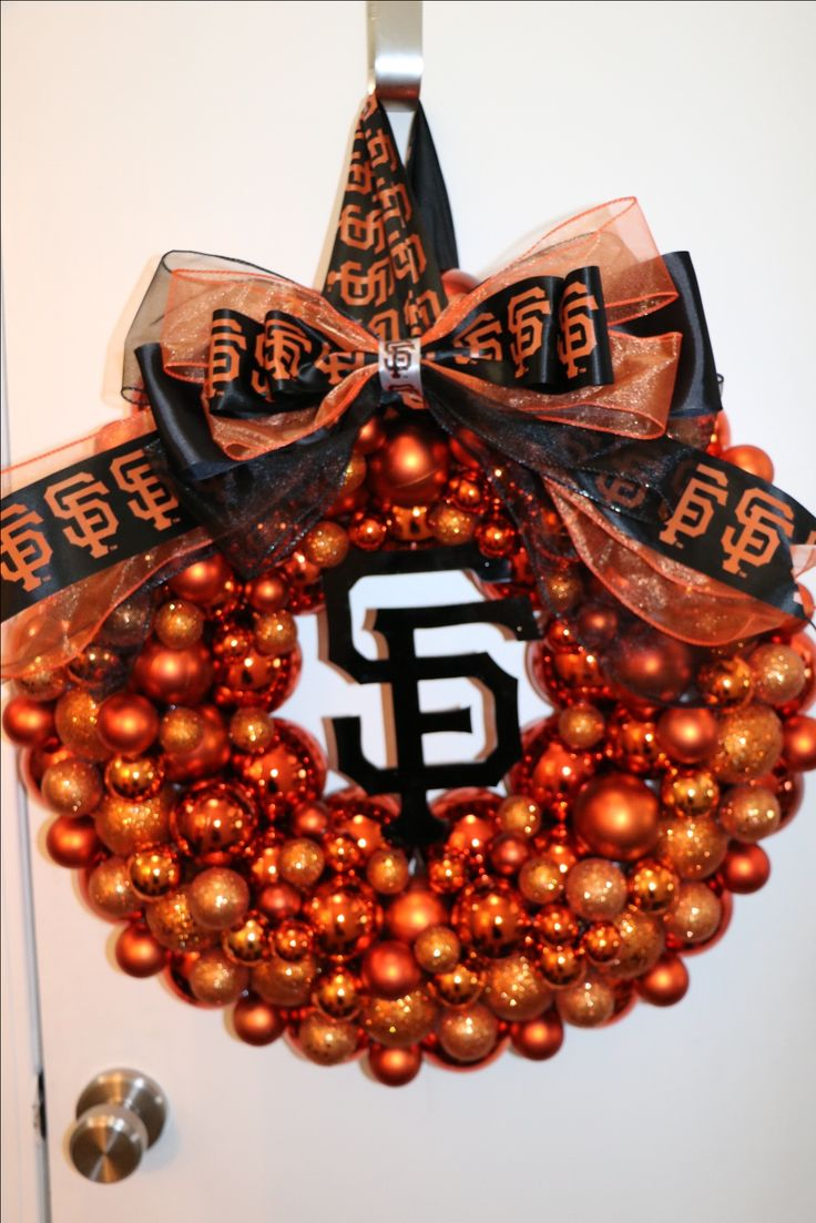 San Francisco Giants Baseball wreath! $100 20% of cost will be donated to the JR Giants program to help local youth! https://www.etsy.com/shop/SarasNickNacks #sarasnicknacks #baseball #baseballwreath #giants #giantswreath #SFGwreath #bayareasports #bayareabaseball #ornamentwreath #orangeandblack #bow