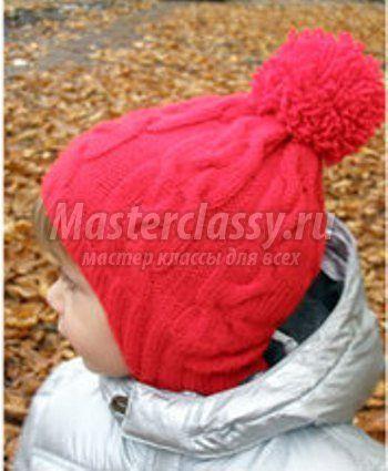 Теплая вязаная шапка спицами для девочки