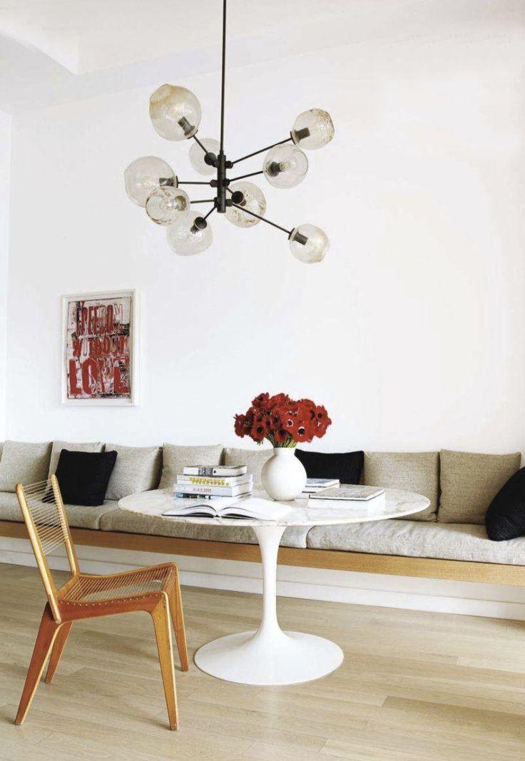 A modern-interpretation of my dream kitchen: built-in breakfast nook, marble top, bubble light, red/black/tan...
