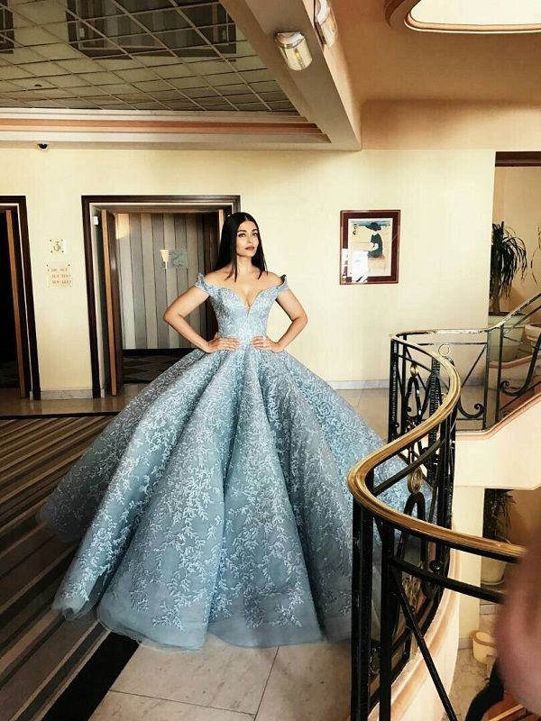 We can't get enough of Aishwarya Rai Bachchan at the French Riviera. Prior, during the day, the Indian beauty gave us two stunning looks during her media interactions, however nothing could have set us up for the stunner she through our way in this flawless Cinderella-inspired blue gown. The off-shoulder gown with a sweetheart diving…