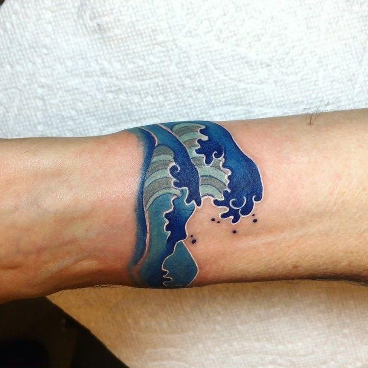 "5dfaf3711 Emma Grace on Instagram: ""Thanks Jack! #waves #tattoo ##blue #ink # wavetattoo #colortattoo #armband #inked #inkstagram #tattooed  #thebestpaintattooartists…"""