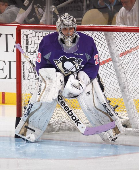 Marc-Andre Fleury of the Pittsburgh Penguins wears a #HockeyFightsCancer Jersey during warmups.